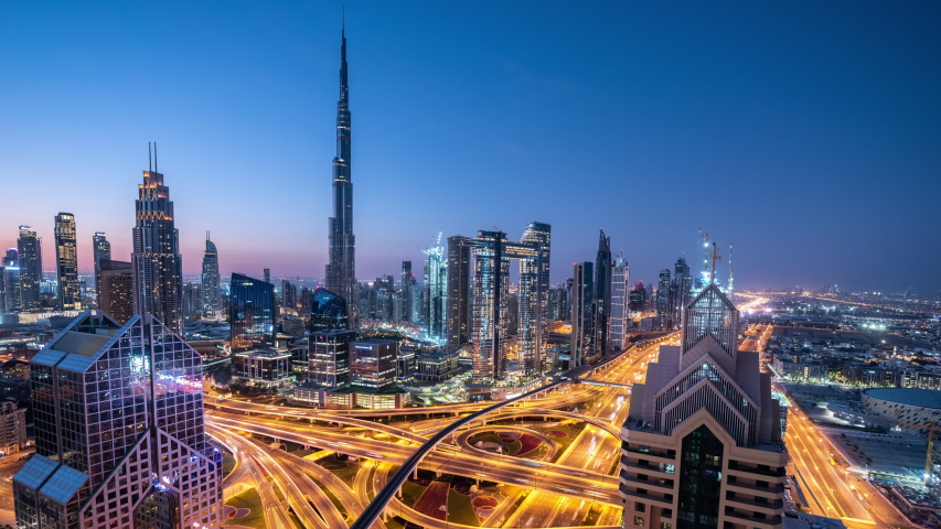 Time lapse Aerial view and top view of traffic on city streets in Dubai.Expressway with car lots. Beautiful roundabout road in the city center. | Shutterstock HD Video #1054094282