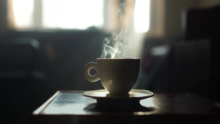 steaming Cup of coffee or tea Royalty-Free Stock Footage #1054095083