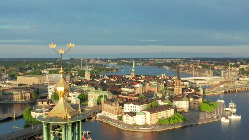Drone shot Stockholm City Hall Old Town Gamla Stan aerial view. Summer evening in on of the most beautiful cities in the world. Cityhall from above in Sweden Royalty-Free Stock Footage #1054095221