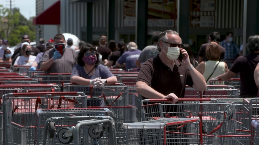 Los Angeles, CA/USA.Circa 05/2020.   people waiting in a line for shopping at supermarket in LA during Covid-19 coronavirus pandemic.