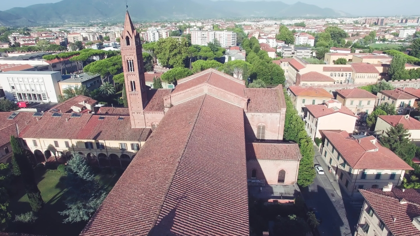 Aerial view of Church and Town in Pisa on a beautiful summer afternoon, Tuscany, Italy in slow motion.   Shutterstock HD Video #1054104308