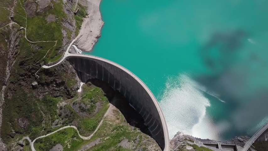 Flight over of Kaprun high mountain reservoir Mooserboden Stausee in the Hohe Tauern, Salzburger land, Austria. Royalty-Free Stock Footage #1054105838