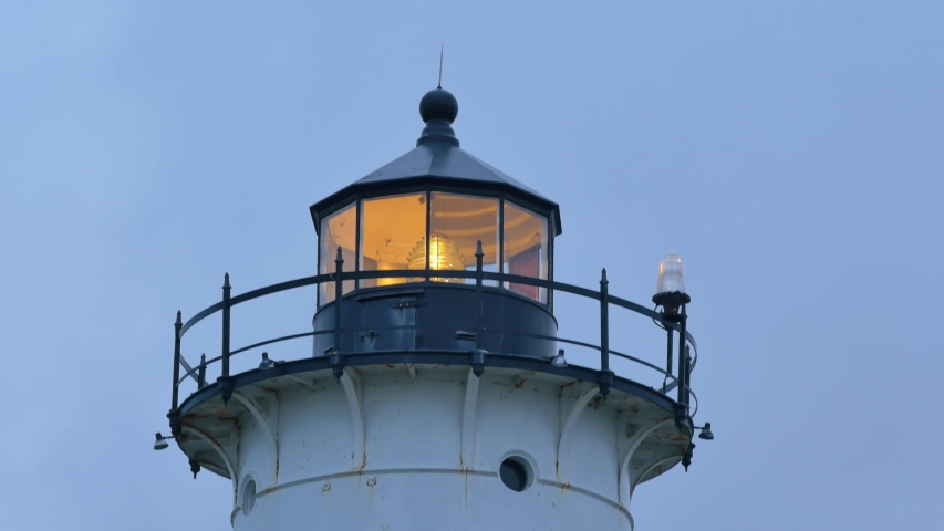 Close up shot of Nobska Light with rotating Fresnel lens in a dusk time in Woods Hole, Massachusetts, United States