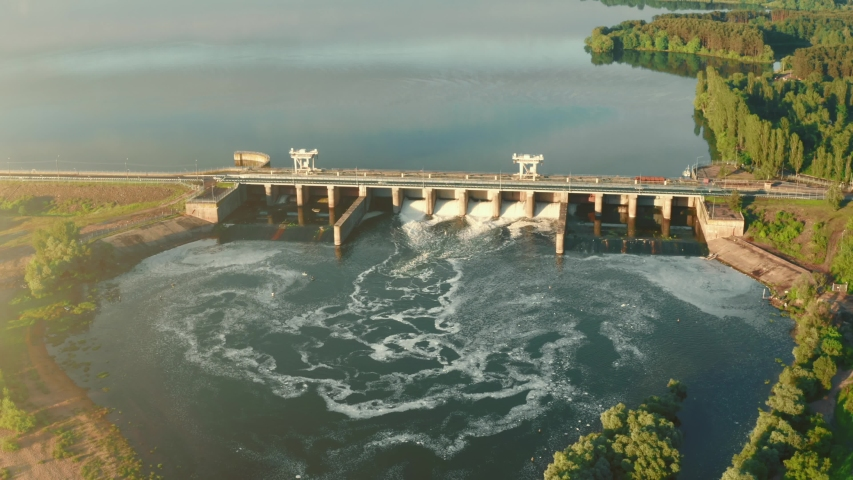 Aerial panoramic view of Hydroelectric Dam on river at sunset Royalty-Free Stock Footage #1054108796