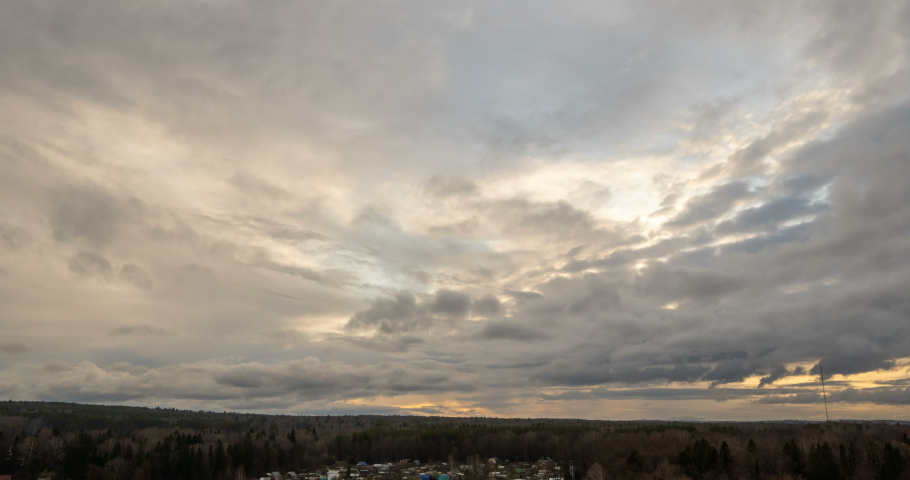 Evening clouds fast moving away, rolling dark sunset clouds 4k black gray white blue glow sunset sky cloud black gray cloudscape time lapse 4k background dark black white sunset sky cloud timelapse