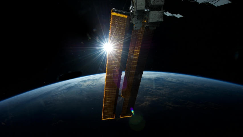 Sun shining off of solar panels from a space station orbiting Earth 4K
