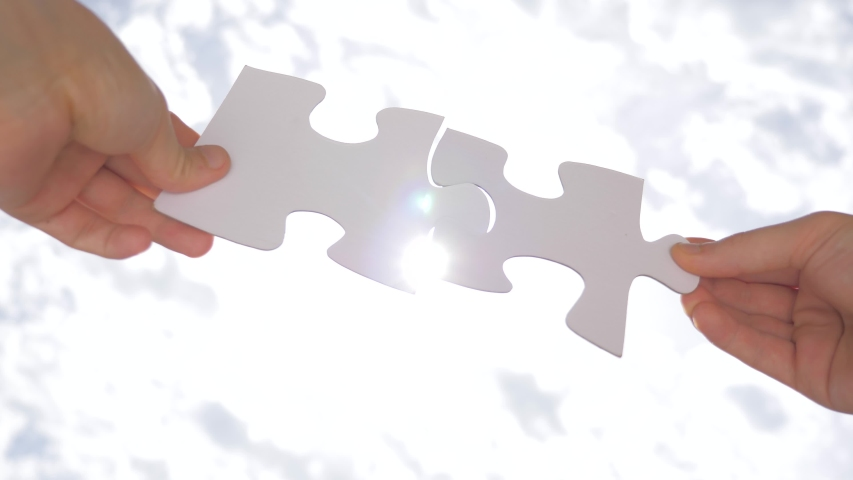 Two pieces of puzzle are interconnected. Problem solution concept. Relationships concept. Successful negotiations. Communication concept Social psychology of close relationships. Problem solving skill Royalty-Free Stock Footage #1054110800