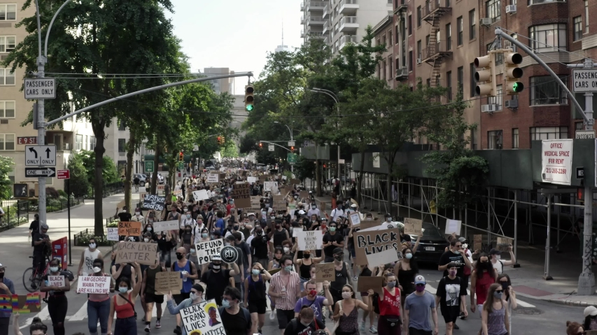 NEW YORK - JUNE 10, 2020: peaceful Black Lives Matter protestors marching up 5th Avenue with signs after rally in Washington Square Park, in New York City, NYC.