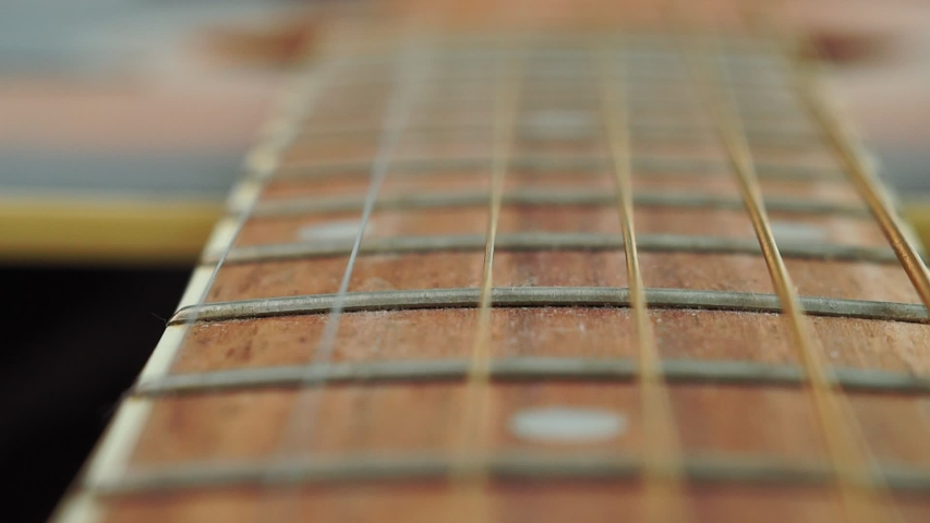 Close up macro on guitar strings. Musical instrument concept. Music and sound. | Shutterstock HD Video #1054135601