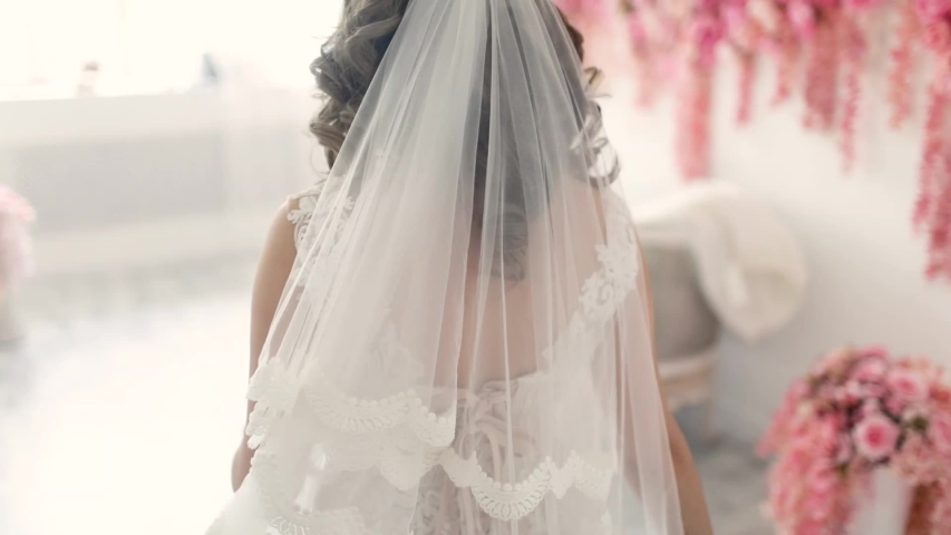 Beautiful bride is spinning in a wedding dress. The bride in her wedding dress is spinning in the room | Shutterstock HD Video #1054142486