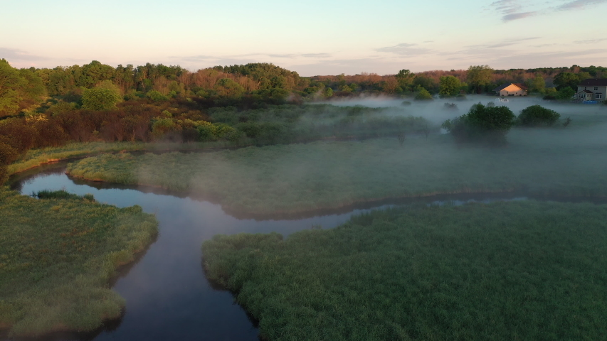 Aerial view of american countryside in the summertime. Sunrise, dawn, misty early morning. North american rural landscape,  beautiful nature of Midwest (Wisconsin)