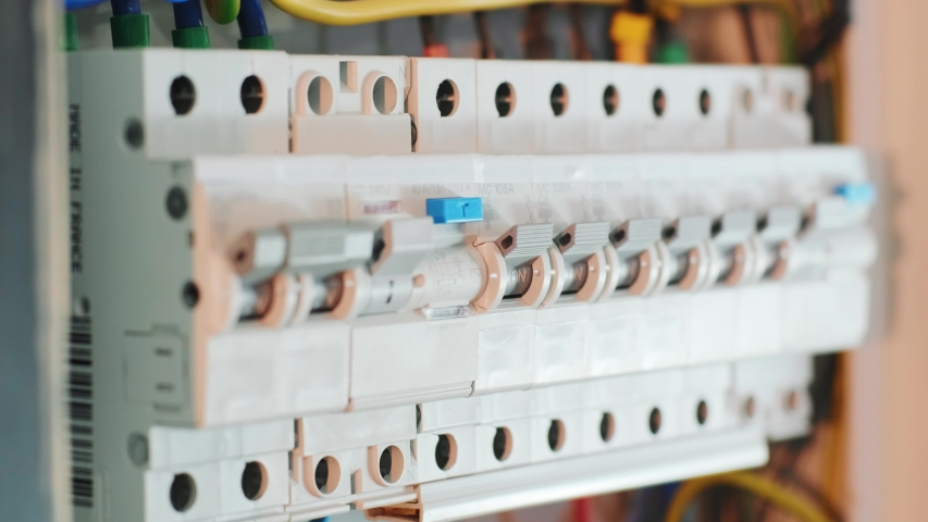 Close-up Of Hand On Switch Of Distribution Board. Man switching on fuseboard Royalty-Free Stock Footage #1054147121