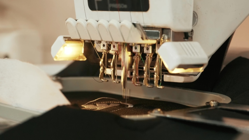 The automatic embroidery machine is working at high speed. Close-up | Shutterstock HD Video #1054147160