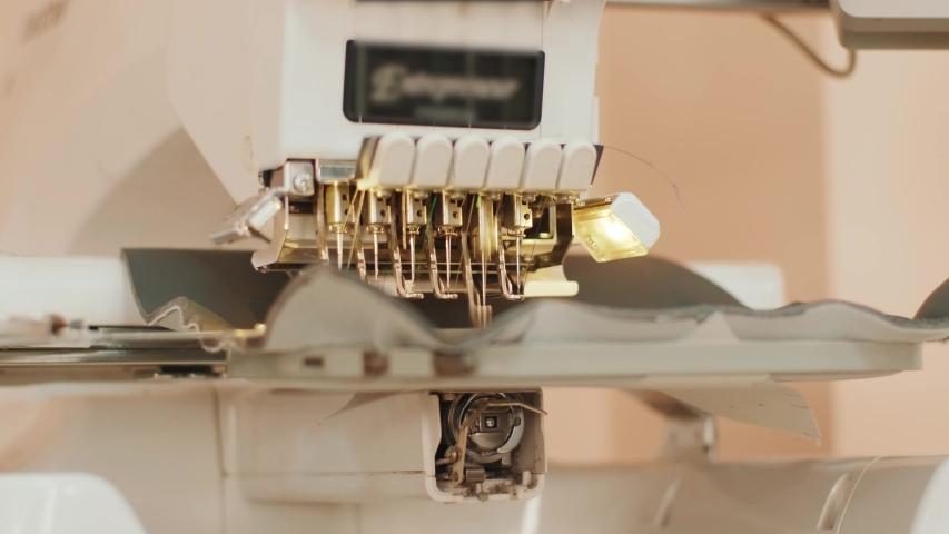 The automatic embroidery machine is working at high speed. Close-up | Shutterstock HD Video #1054147181