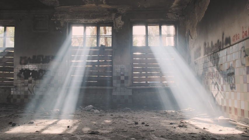 Abandoned building with boarded up windows with trash on floor. Royalty-Free Stock Footage #1054160423