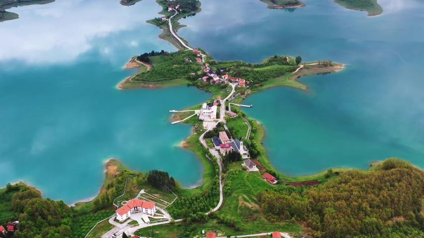 Aerial reverse above Ramsko turquoise lake, Bosnia and Herzegovina | Shutterstock HD Video #1054175291