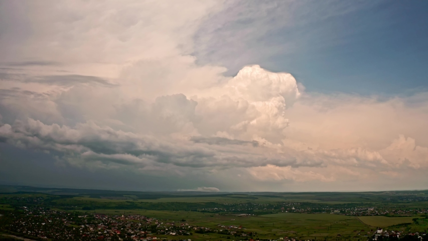Aerial drone view. Big white cloud. Coming hard thunderstorm | Shutterstock HD Video #1054178090