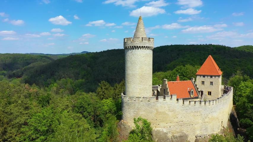 Aerial view of medieval castle Kokorin nearby Prague in Czechia. Central Europe. Medieval gothic castle Kokorin, Kokorinsko protected landscape area in Czech Republic. Medieval gothic castle Kokorin. | Shutterstock HD Video #1054178723