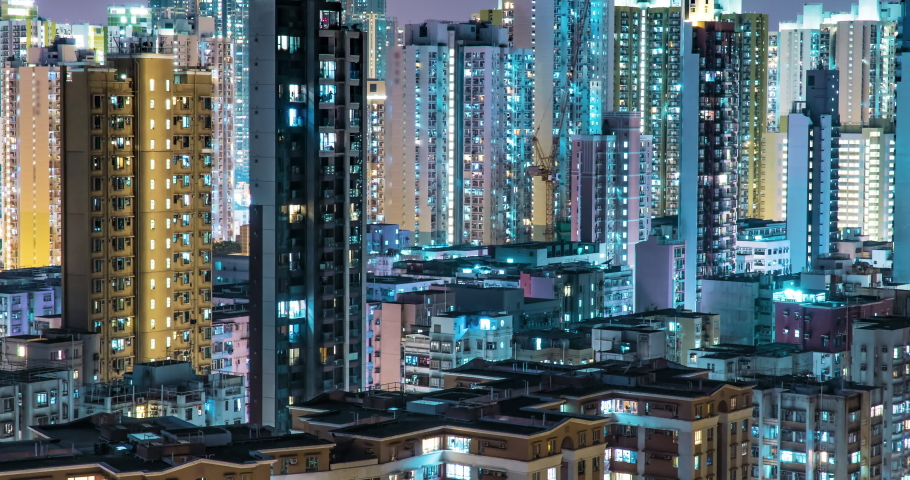 Residential Buildings' Windows Twinkle at Night. Crowded City With Lights Turning On And Off at Midnight. Time Lapse Urban Cityscape. Royalty-Free Stock Footage #1054182899