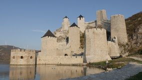 Slow pan on towers of Golubac fortress on Danube river 4K video