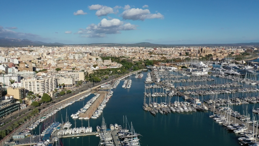 Drone panning at the city of Palma (Mallorca). Harbour of Mallorca drone shot. | Shutterstock HD Video #1054188641