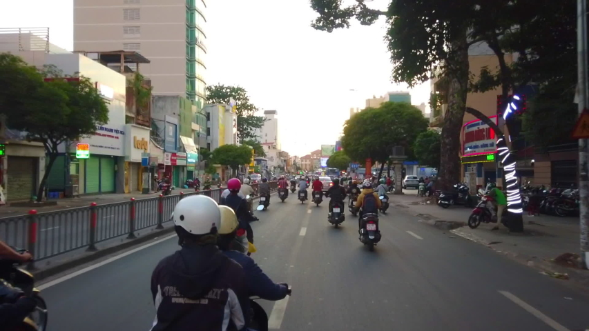 POV Traffic jam in Sai Gon, Ho Chi Minh city, Vietnam timelapse sunset after working hours, rush hour, footage of people, life, traffic, overpass bridge, sign, motor bike Royalty-Free Stock Footage #1054194641