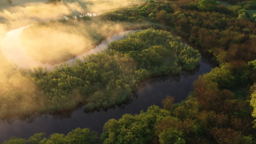 Aerial view of american countryside in the summertime. Sunrise, dawn, misty early morning. North american rural landscape,  nature of Midwest | Shutterstock HD Video #1054207193