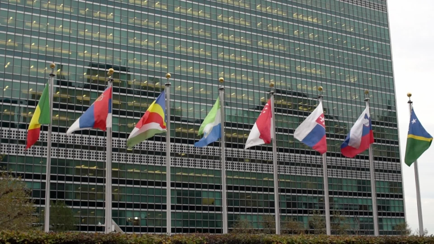 Multiple flags in front of the United Nations headquarters in New York City