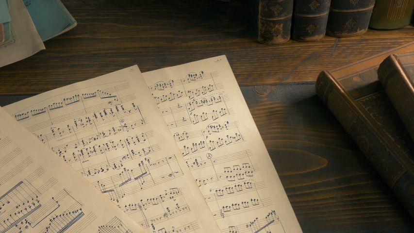 Hand-Written Sheets Of Music On The Table