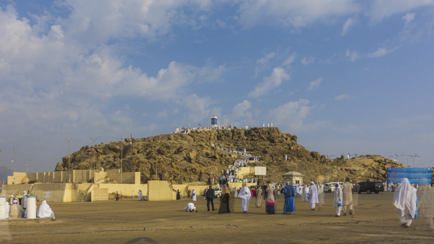 Time lapse of Muslims at Mount Arafat (or Jabal Rahmah) in Arafat, Saudi Arabia. This is the place where Adam and Eve met after being overthrown from heaven. Prores UHD