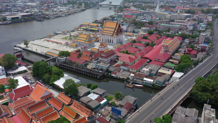 Aerial video of Wat Arun and Bangkok city skyline. Wat Arun is the old temple located near Chaophraya river in Bangkok of Thailand. | Shutterstock HD Video #1054252238