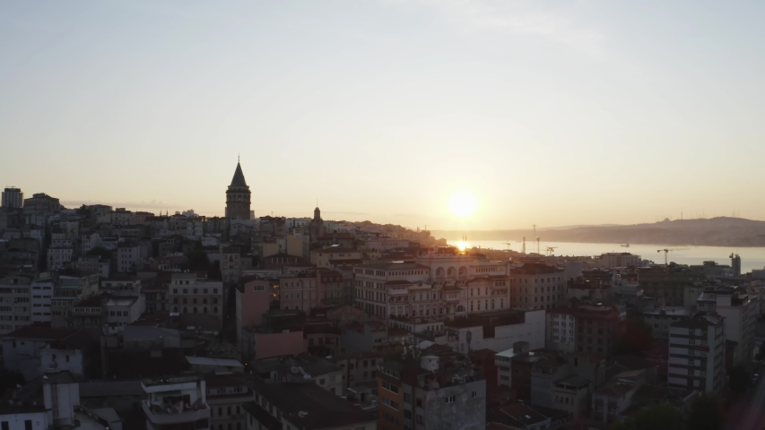 Aerial view sunrise of Galata Tower and Beyoglu. Empty Streets without people. Quarantine days. Istanbul Historical Peninsula Landscape. 4K Footage in Turkey Royalty-Free Stock Footage #1054263812
