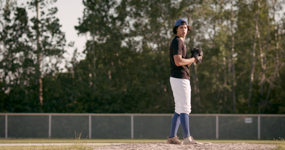 Perfect fastball pitch. Baseball pitcher throws hard pitch. Heat down the plate from a young pitcher. Shot in 4k.