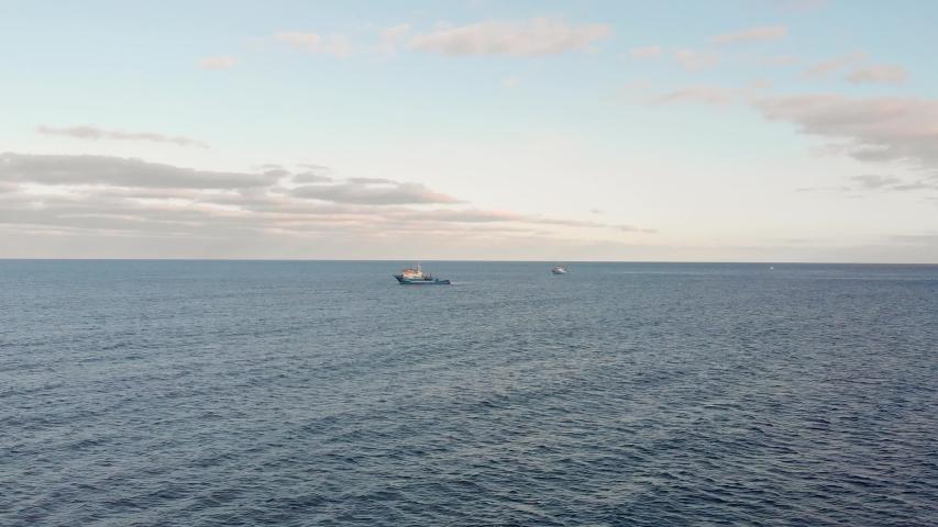 Drone flies toward a trawler fishing boat in the Atlantic Ocean, Portugal