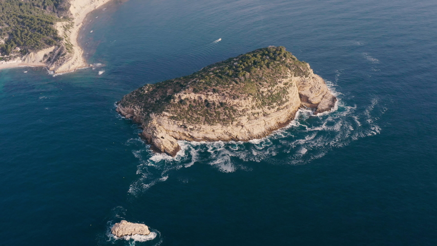 Aerial view of the islet of Portichol in the coast of Javea, Spain. | Shutterstock HD Video #1054280249