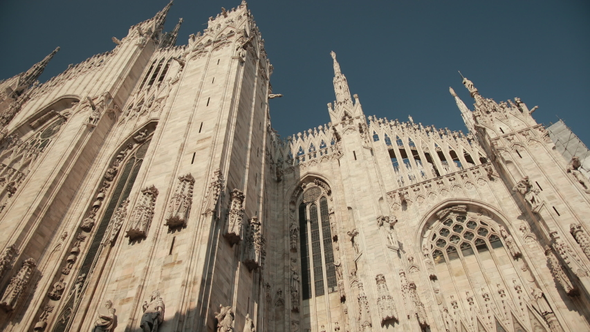 The World-Famous Duomo In Milan, Italy, Lombardy. Close-Up View From Below. A Magnificent Religious Catholic Building. Bright Sunny Day. | Shutterstock HD Video #1054288352