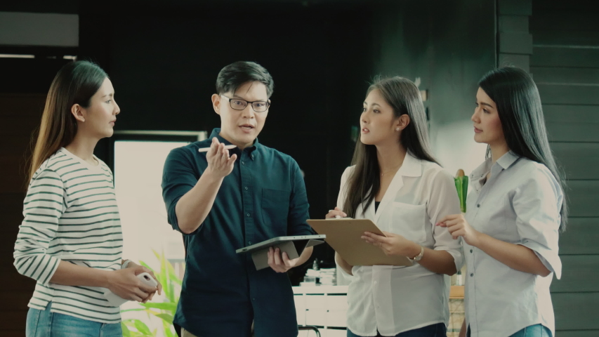 Asian business team talking in a home office meeting. Brainstorm the most successful work agreement in today's economy. Collaboration in teamwork. Concept Business New Normal Royalty-Free Stock Footage #1054289051
