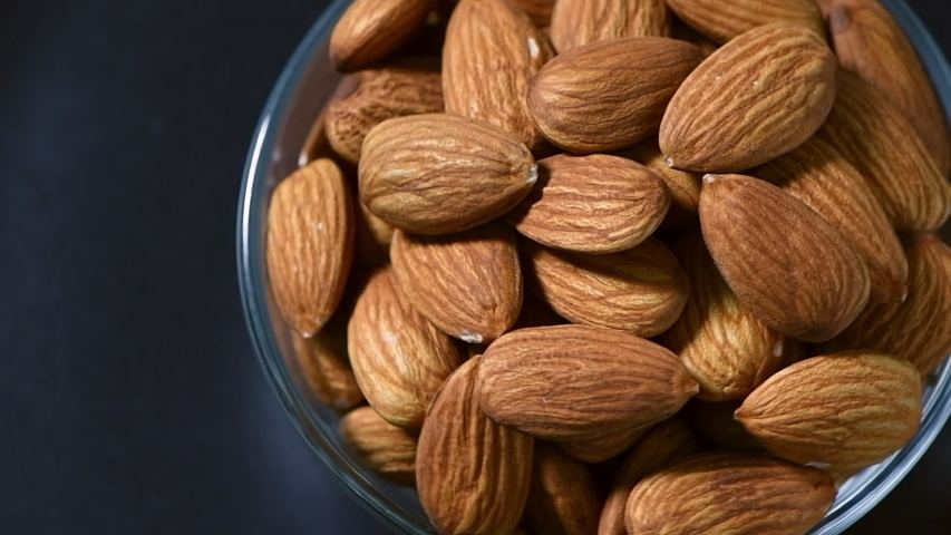 Nut almond close up in bowl. product rich in minerals and vitamins. Almond turns in a shot. Almond kernels rotating. slow motion. | Shutterstock HD Video #1054290290