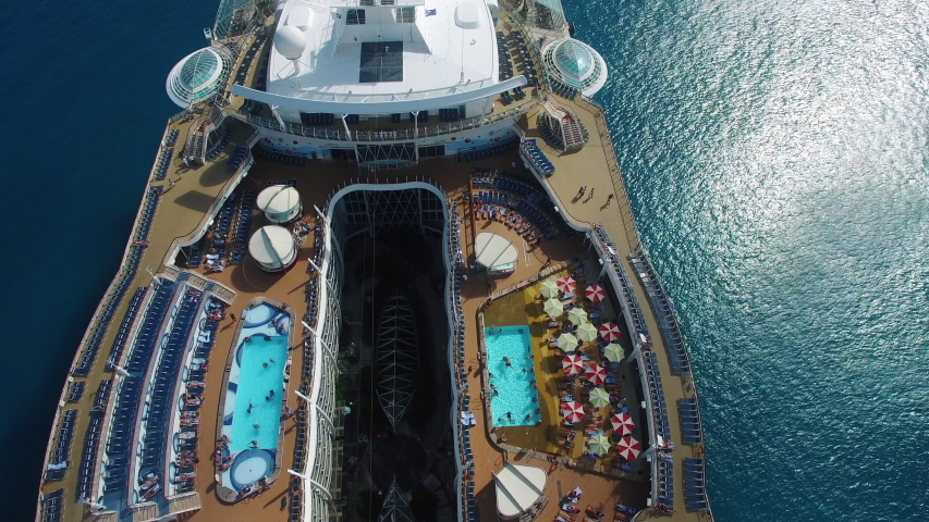 Close up aerial footage of a cruise ship sailing on the Caribbean sea.  | Shutterstock HD Video #1054290488