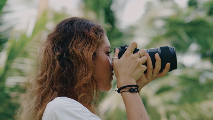 Revolving around a woman photographer in the jungle Close-up of full 360 degree rotation. Tracking Arc Shot   Shutterstock HD Video #1054294754