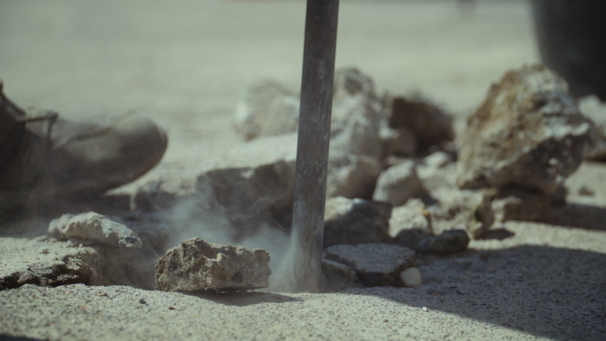 Close up of a pneumatic hammer breaking concrete in real time | Shutterstock HD Video #1054295414