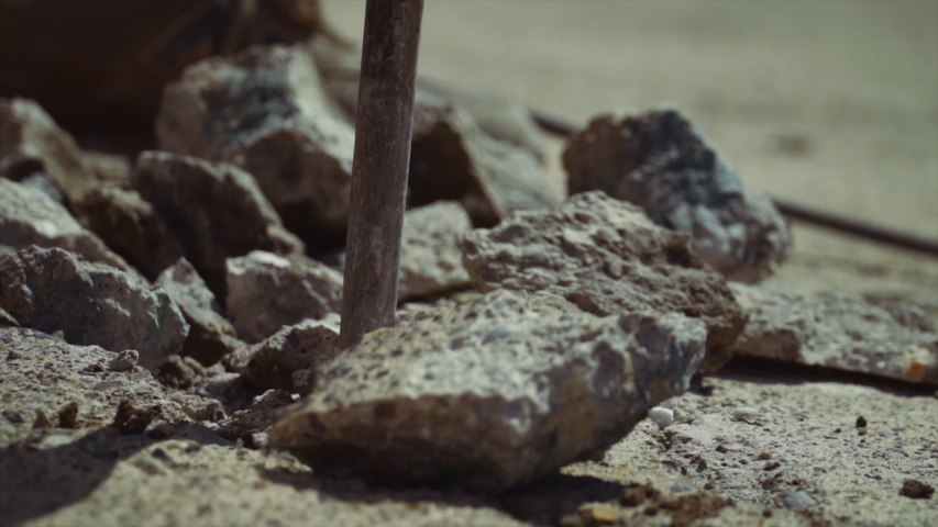 A slow motion of a pneumatic hammer breaking concrete | Shutterstock HD Video #1054295417