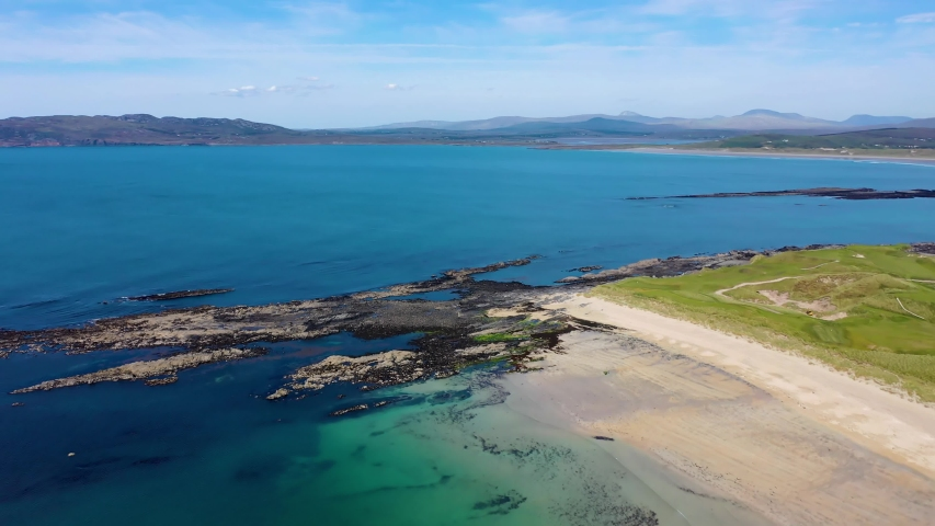 Aerial view of the awarded Narin Beach by Portnoo and Inishkeel Island in County Donegal, Ireland. | Shutterstock HD Video #1054295996