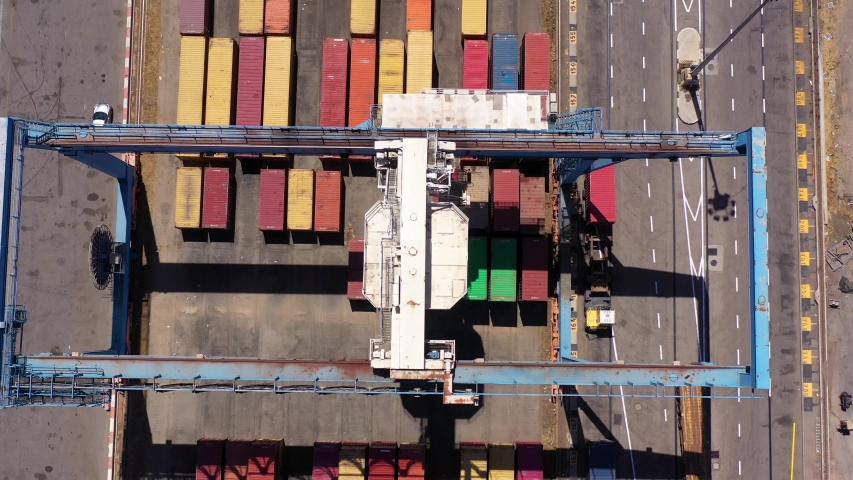 Aerial view over Rows of Shipping Containers Ashdod Harbor,  Drone view.Ashdod, Israel, June 14, 2020.  | Shutterstock HD Video #1054297658