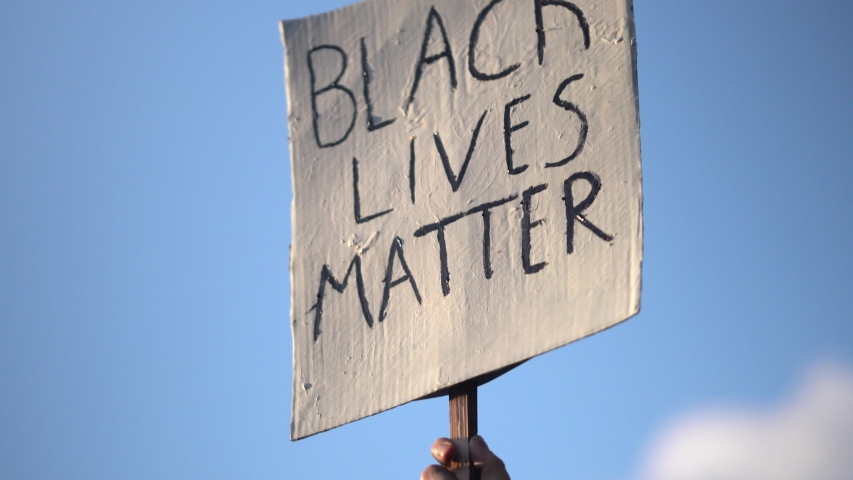 Black Lives Matter Board Held At Protest Rally, 4K. | Shutterstock HD Video #1054299821