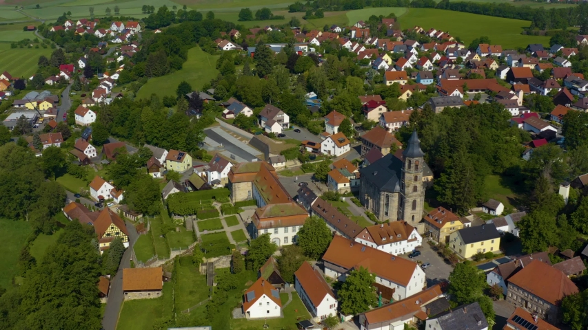 Aerial view of the city and monastery Neudrossenfeld in Germany on a sunny day in spring. During the coronavirus lockdown. | Shutterstock HD Video #1054302944