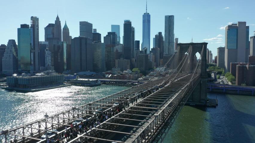 Alt flying backward view of BLM marchers streaming across Brooklyn Bridge towards NYC   Shutterstock HD Video #1054306151