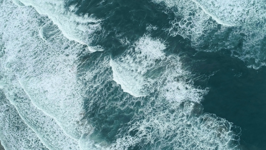 Turquoise waters of great ocean. Whitecaps rolling the surface during light storm. Aerial top down shot, UHD | Shutterstock HD Video #1054311743