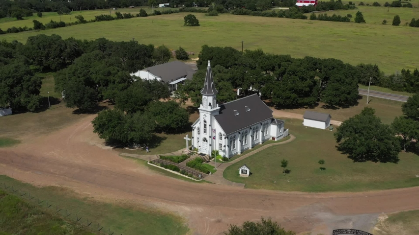 Rural Catholic Church and flags, Dubina, Texas, USA