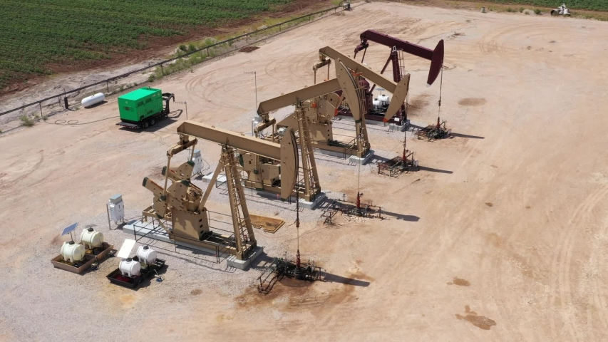 Four oil wells pumping petroleum, Brazos County, Texas, USA